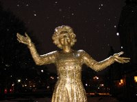 Statue of actress Wenche Foss by night