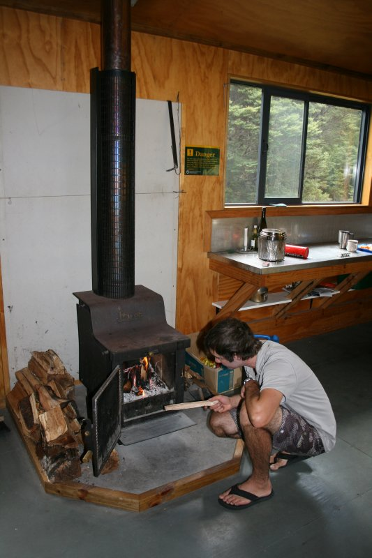 Stoking the Stove in Crow Hut
