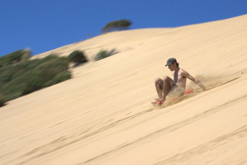 Sand Tobagganing at Tauroa Point Reserve