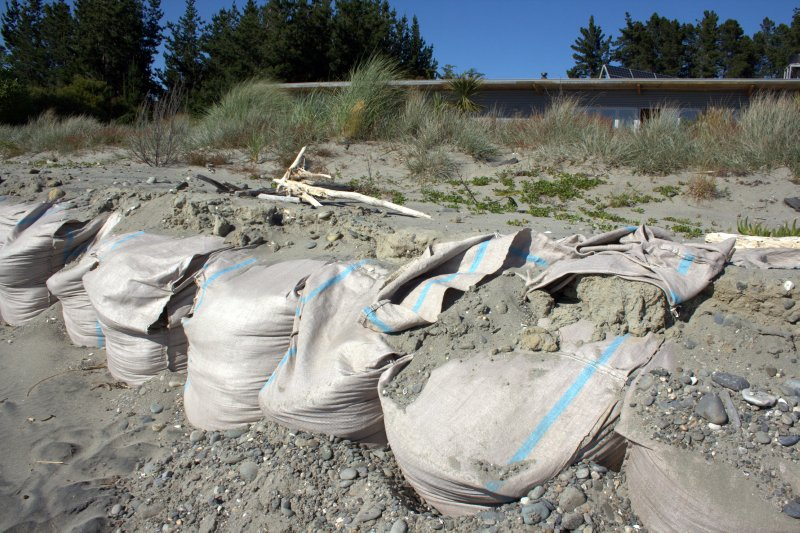 Sacks Filled with Concrete infront of Home