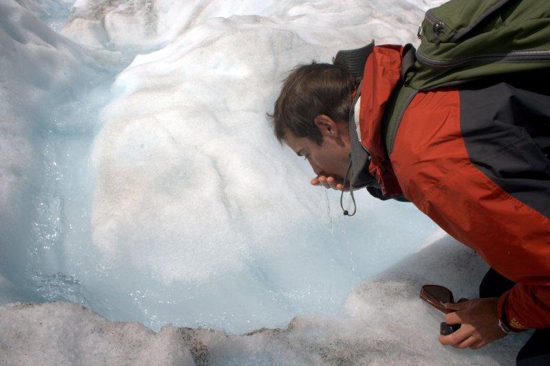 Slurping Glacial Water on Fox Glacier