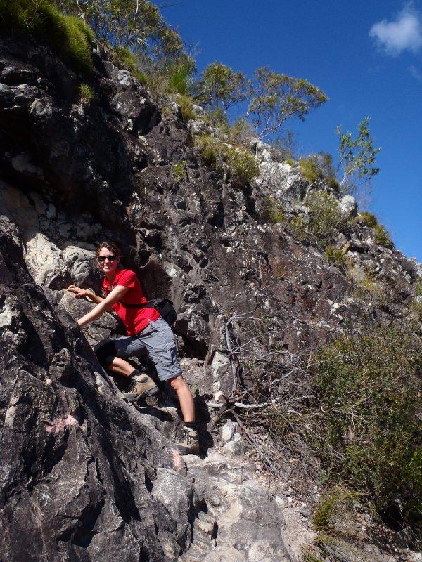 Julie Hanging onto Mt. Tibrogargan