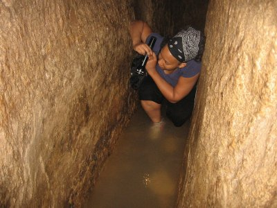 Me troopin' it through Hezekiah's Tunnel (checking out something on the wall i guess)