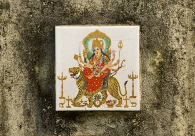 Durga tile in Paharganj - tiles of Gods are placed in alleys and areas to discourage public urination!