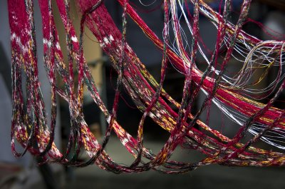 Dyed threads ready for ikat weaving