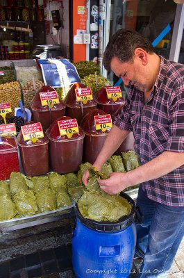 In the Egyptian Market, grape leaves and pepper masalas for sale!