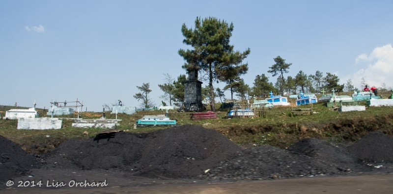 Passing through a coal producing area, neighbouring a cemetary