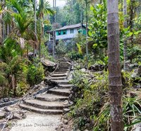 Arriving at the bottom of the 2004 steep concrete steps and the town of Nong Thymai
