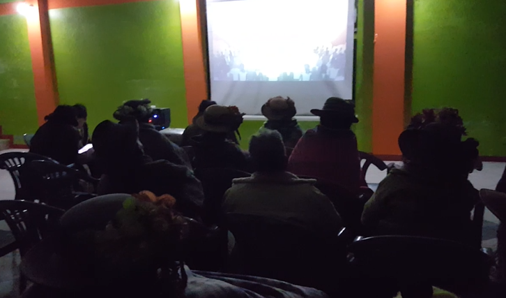Here you can see the people watching the video, What is God's Kingdom in Quechua Cusqueño, being shown on a projector by way of a tablet