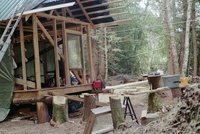 Cabin will have front porch, & 1/2 loft with ladder.