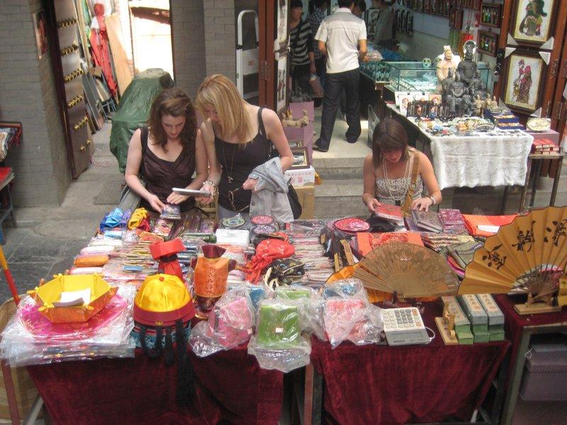 The girls picking their way through tourist knick-knacks
