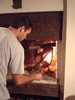 Matt getting the Parrilla coals/logs burning