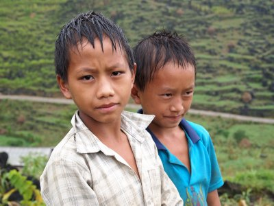 Two little boys on the side of a mountain road, Ha Giang