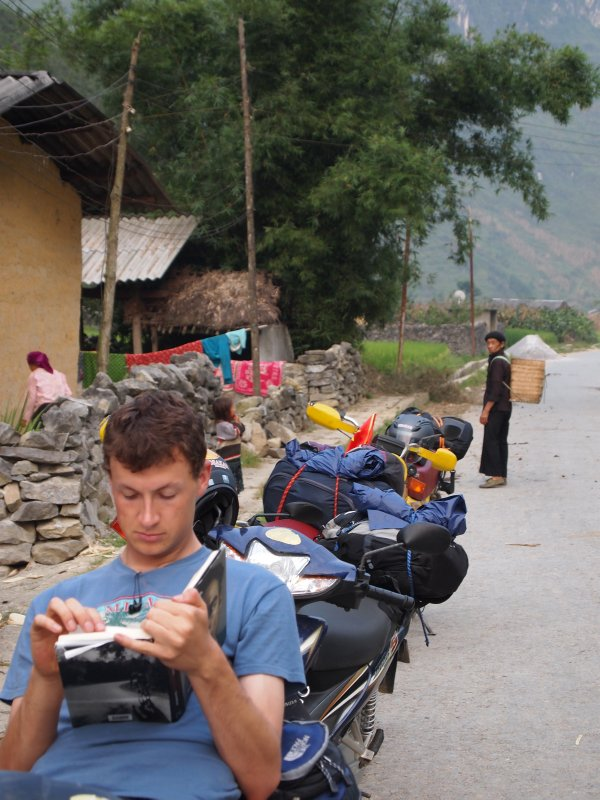 Ed reading - even the Hmong man behind him couldn't believe it!