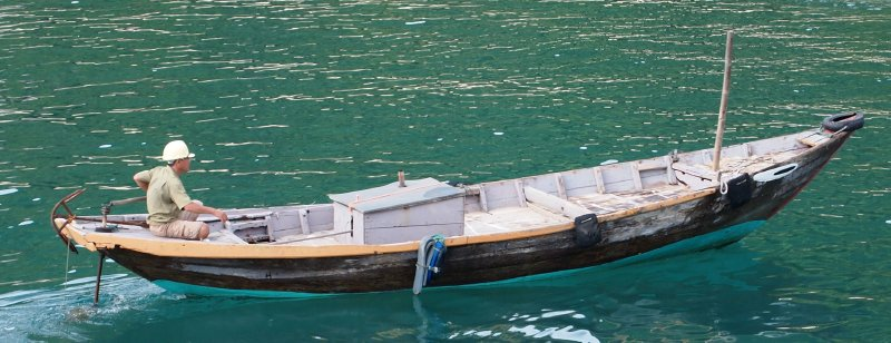 The safety boat off the Cham Islands; thank heavens he was wearing a hard hat