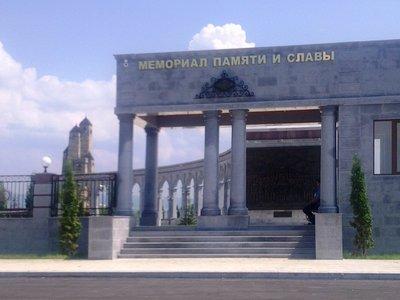 Ingushetian War Memorial with typical Nakh Tower (behind)
