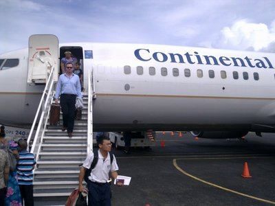 ... on Continental Airlines. (Best friend Harald on gangway with stylish Berluti kit.)