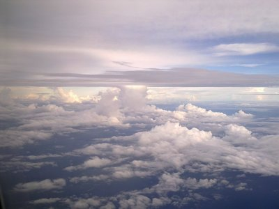The usual atomic mushroom clouds while approaching the Marshall Islands.