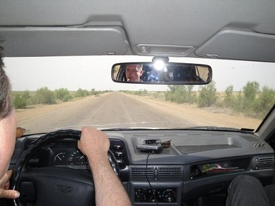 Raided our Uzbekistan taxi from its driver. Speeding over the Silk Road near Bukhara.