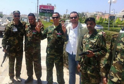 Celebrating their victory: former Gaddafi soldiers turned freedom fighters