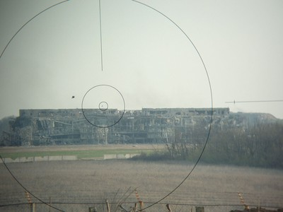 Ruins_of_Donetsk_International_Airport_with_Russian_flag_on_top.jpg