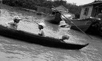Kids playing on Tonle Sap lake in Siem Reap Cambodia
