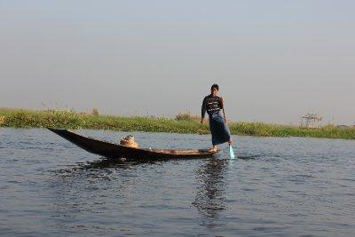 boy rowing with leg