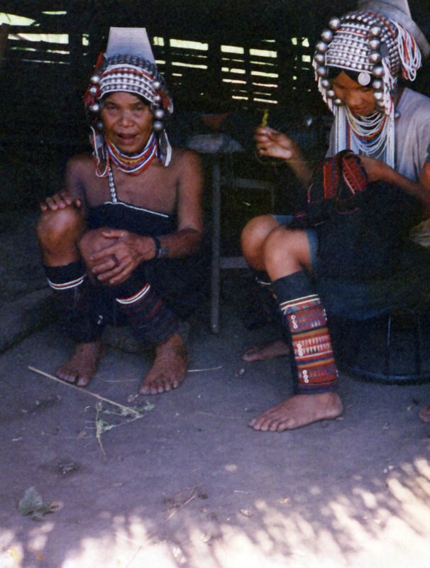 Akha hill tribe women sewing on their porch.