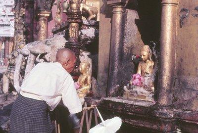Devotee at shrine, Shwe Dagon