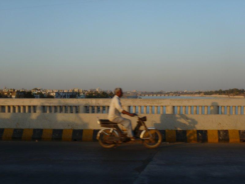 Crossing the bridge across the river