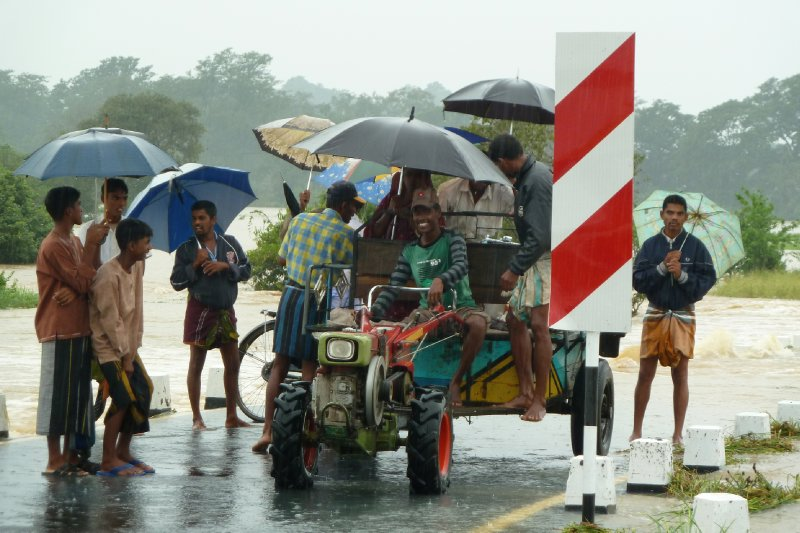 Locals shield from the rain on the east coast
