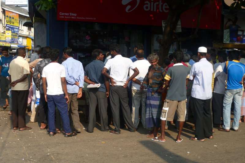 Members of the public watching the match any way they can