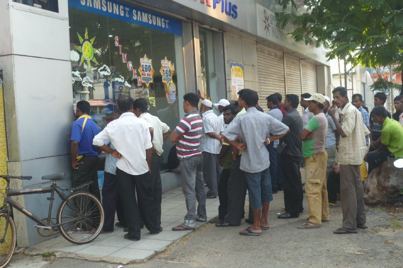 Suppoerters gather outside an electical store