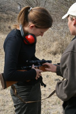 Emma reloading the rifle
