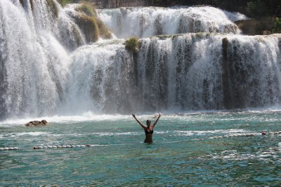 Ana swimming under the large Krka waterfall