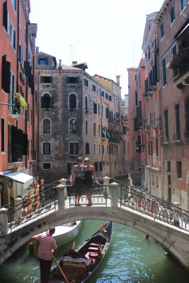 Bridges over small canals connect Venice alleyways