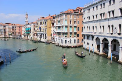 Three gondoliers and the Grand Canal
