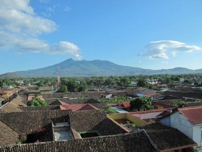 A rooftop view and Volcano Mombacho puffing in the background