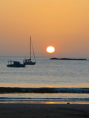 The sun setting over San Juan del Sur