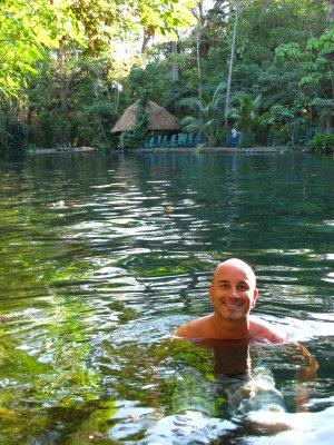 Andrew swimming in the healing waters of Ojo de Agua