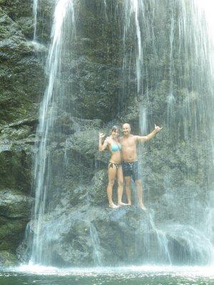 Ana and Andrew under the waterfall in Montezuma