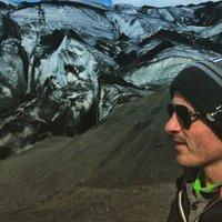 Posing at the foot of a glacier