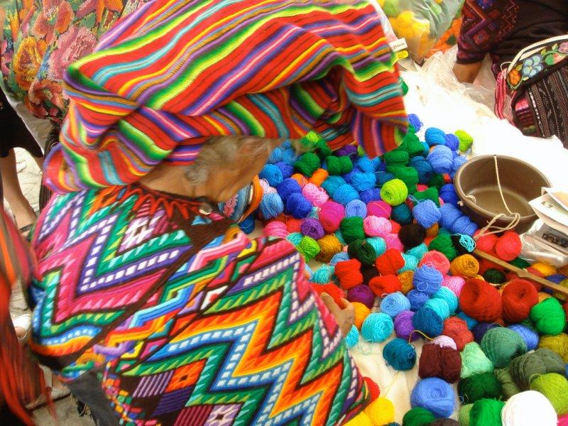 Lady shopping yarns at the market