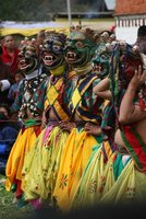 Masked dancers in Bumthang
