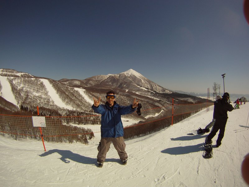 Brendan on top of Alts Ski Area Bandai Mt. in the background!