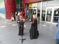 Wizards Playing Violins Outside Cinema, Victoria