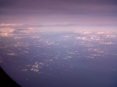 up and above the clouds going to Singapore