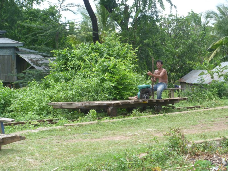 large_man_on_bamboo_train.jpg