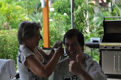 having a haircut ... made by my thai auntie