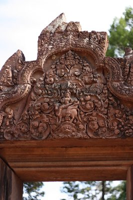 "I've appreciated the detailed carvings on the temples in Cambodia, but the carvings here are even more intricate than the others.  People guess that only women's delicate hands could produce such beauty, so this temple is known as ""Citadel of the Women"""